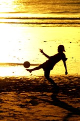 futbol (Farl) Tags: travel sunset bali game beach colors silhouette ball indonesia gold coast football kid sand bravo play soccer tradition jimbaran