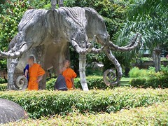 Triple headed elephant with monks in shade (Rory OBrien) Tags: sculpture elephant umbrella monks shade laos vientiane xiengkhuan