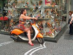 shoe shopping by bike (jovike) Tags: street city people urban italy orange bike shop retail shopping shoes italia display pavement candid transport scooter motorbike motorcycle napoli naples heels vehicle corsoumberto