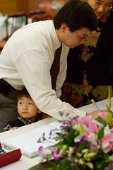 Signing in (Lisa and Erik's wedding shindig, May 2006) Tags: justin banquet guestbook mrpan