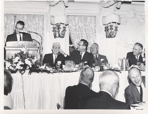 vintage man presenting speech in the company of gentlemen