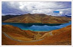 Yamdrok-Tso Lake (exhibitj) Tags: china lake topf25 d50 landscape nikon dam turquoise tibet holy sacred waters bloody tso 1870 nikonstunninggallery yamdroksto
