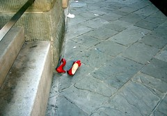 disappeared (loungerie) Tags: street red 2 two abandoned mystery shoes strada noir pair enigma mysterious lonely rosso due trieste scarpe filmnoir copertina mistero solitarie