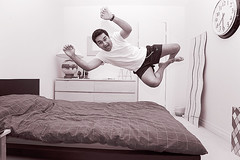 i go to bed like this every night! (soroush2) Tags: pictures people toronto canon photography crazy jumping bed bedroom going 5d maniac bedding soroush