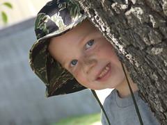 AJ behind a tree