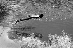 Flying Souls (HappyHorizons) Tags: bw india reflection water smile kids swim jump jumping action dive mybest streetchildren bsb thepca 1on1photooftheday bangaloreweekendshoot abigfave bsbmybest pcaaction