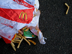 Scattered McDonalds, Highgate Hill, North London, 10-09-06, 10-09-06 (DG Jones) Tags: mess ketchup sunday fastfood nation apocalypse chips mcdonalds litter fries torn armageddon highgate highgatehill consumerism excess gluttony indiansummer northlondon wouldyoulikefrieswiththat scuzz ericschlosser repugnance