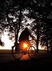 aurora bicyclalis (Dan65) Tags: road old light sunset red orange man bike bicycle silhouette yellow dark austria bravo aurora cycle asphalt lowdown aura abigfave