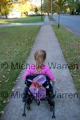 © The Long Road (Light Saver) Tags: family fall leaves fun looking walk wheelchair sidewalk utata anastasia stroll along rolling spinabifida donotcopy nikonstunninggallery michellewarren warrenphotography twtmesh140725 donotusewithoutwrittenpermissions allmyimagesarecopyrighted heritage2011 gettyimagescurators ignoranceofcopyrightlawsisnoexcusetobreakthem allimagesarelicensedthroughgettyimages contactmewithanyquestions