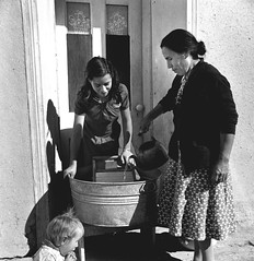 Doing the family washing (John Collier Jr.) Tags: blackandwhite bw usa history classic film museum america vintage collier children us photographer unitedstates propaganda wwii documentary patriotic roosevelt historic professional worldwarii 1940s archives maxwell ww2 americana civildefense patriotism archival forties largeformat anthropology homefront worldwar2 40s fsa wartime newdeal owi waryears farmsecurityadministration officeofwarinformation johncollierjr