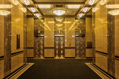 From the Gilded Age (USpecks_Photography) Tags: fuller fullerbuilding symmetry elevators golden reflection entryway hallway architecture artdeco