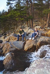 Dustin Holmes and Kati Sharp (Adventurer Dustin Holmes) Tags: people person male boy guy man human dustinholmes dustinkholmes dustinkeithholmes adventurerdustinholmes taumsaukmountain statepark missouri ozarks midwest southernmissouri girl female young woman katisharp water creek stream rocky landscape boulders trees forest woods outdoor greentshirt greenshirt sitting whiteshoes bluejeans jeans