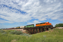 Eastbound Cody local (Moffat Road) Tags: bnsf local localfreight emd gp383r bridge trestle clouds sky vocation ralston wyoming codylocal woodtrestle 2392