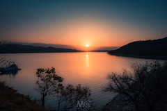 A spectacle of the creation (Mariano Colombotto) Tags: dique dam water lake sunset atardecer tucuman argentina sun sol nature landscape reflection tones colours travel ngc beauty sky cielo nikon greatphotographers