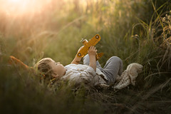 Under the summer sky (iwona_podlasinska) Tags: boy plane toy airplane grass relax relaxing dream dreaming