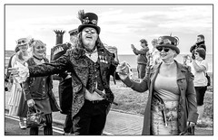Come and be a steampunk (Photography And All That) Tags: steampunk steampunkweekend whitbysteampunkweekend whitby july 2018 man woman people procession festival fun humour costumes victorian scifi medals sunglasses goggles pattern sword pistol flintlock jewellery chains flamboyant expansive gesture hats outdoors sea coast smiles smiling expressions expressive sony sonyalpha7mark3 sonyilce7m3 sonyalpha ilce7m3 yorks yorkshire blackwhite blackandwhite monochrome monochromatic monochromes