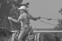 Keep Calm and Sparkle On (clarkcg photography) Tags: cowgirl woman horse rope saddle arena practice calfrope country oklahoma rodeo blackandwhite blackwhitebw bw portrait