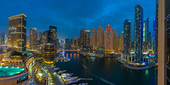 Metropolis (Katherine Young) Tags: cityscape pano view vista panorama uae emirates middleeast unitedarabemirates urban destination holiday bluehour lights reflection hotel skyscrapers towers buildings residential apartments flats trails architecture modern contemporary highliving highrises travel tourism dubai marina dubaimarina yachts boats
