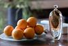 Sun-drenched oranges (RIch-ART In PIXELS) Tags: orange fruit art glassart sunlight fujifilmxt20 xt20 table ish dish glassdish light abstract colours macro bottle food