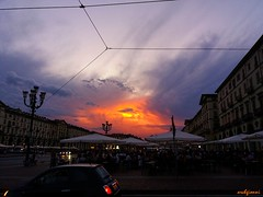 sunset in Turin (archgionni) Tags: buildings piazza square street cars luci lights sky nuvole clouds sole sun tramonto sunset