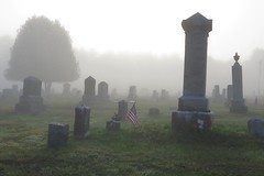 049 Fallen heroes Ridgwell Cemetery Guildhall, VT (cshoemaker) Tags: vermont canon cemetery flag fog gray outdoors summer