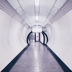 Underground (Olly Denton) Tags: tunnel walkway tiles tiled lights lighting doors lift perspective vanishingpoints reflection underground architecture architecturelovers architectureporn architecturephotography architecturalphotography iphone iphone6 6 vsco vscocam vscolondon vscouk ios apple mac shotoniphone holborn london uk