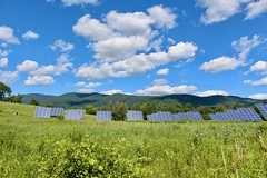 Solar Panel Scape (Read2me) Tags: vermont pree sky clouds blue green grass solarpanels mountain hill challengeyouwinnerunanimous gamewinner thechallengefactory challengeclubwinner