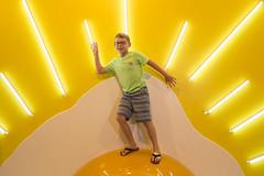 Happy Pose on a Bright Giant Egg (aaronrhawkins) Tags: egg yolk prop hallofbreakfast breakfast saltlakecity pose plastic giant boy smile happy bright lights yellow climb stretch child children food joshua aaronhawkins