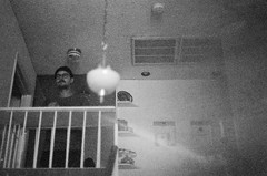 That Counts For Everything (H o l l y.) Tags: lomography canon 35mm film analog bw black white no color stairs balcony man standing spirit foggy grain alone creepy retro indie vintage