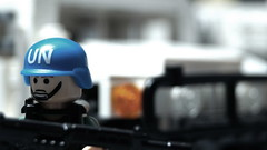 UN peacekeeper on guard duty (Force Movies Productions) Tags: war weapons lego helmet helmets gear legophotograghy rifles rifle toy toys trooper troops troop youtube photograpgh photo picture photograph pose photography postapocalypse animation army soldier stopmotion scene soldiers film firearms guns gun legophotography united un zombie zombies custom conflict cool vest bricks brickfilm brickarms brickizimo brick brickmania nation nations minfig minifig military minifigure minifigs moc