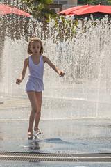 cooling off 7 (stevefge) Tags: 2018 deutschland duitsland germany munchen fountain street summer water splash spray parasol people candid girls kids kinderen children white wet reflectyourworld unsuspectingprotagonists