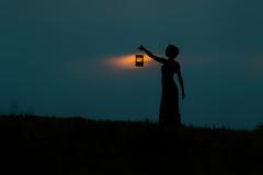 Seek the Light, Enlighten the World (fehlfarben_bine) Tags: nikond800 nikon241200mmf40 woman portrait silhouette field lantern glow hill sundown contrast