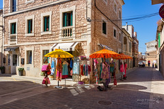 Santanyí 21 June 2018 01047.jpg (JamesPDeans.co.uk) Tags: retail forthemanwhohaseverything landscape doors shutters printsforsale roads windows door objects mallorca commerce street colour majorca jamespdeansphotography spain wwwjamespdeanscouk umbrella architecture green landscapeforwalls europe shops digitaldownloadsforlicence