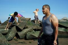 Rocks (dtanist) Tags: nyc newyork newyorkcity new york city sony a7 konica hexanon 40mm brooklyn coney island beachgoers rock jetty shore sand