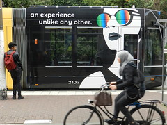Bunq, an experience (JoséDay) Tags: bunq advertisement tram halte haltestelle fiets bike passingby nikon coolpixp500 p500 nikonaward goldfinegroup groupwithexperience art artinthestreet kunstoptram kunstopdetram specsavers brillen bril sunglasses zonnebril