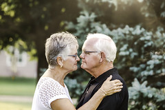 mom & dad (Rebecca812) Tags: mom dad seniorcitizen growingold whitehair grayhair eyeglasses togetherness love family wife husband couple tree people portrait realpeople canon nosetonose candid outdoors woman man 60s 70s anniversary embrace bond sunlight idyllic
