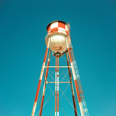 water tower. mojave desert, ca. 2018. (eyetwist) Tags: eyetwistkevinballuff eyetwist water tower mojavedesert checkerboard airport minimalist xpro film analog analogue mamiya6mf mamiya75mmf35l 75mm kodak ektachrome e100vs lenstagger kodakektachromee100vs crossprocessede6toc41 crossprocess crossprocessed mamiya 6mf ishootfilm emulsion mamiya6 square 6x6 mediumformat 120 ishootkodak 100vs epsonv750pro 6 cross process processed saturated contrast sign lines stripes angles desert daggett barstow dag storage girder ladder infrastructure gravity