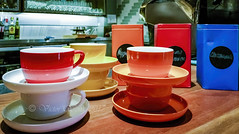 Cups and saucers (Victor Wong (sfe-co2)) Tags: cup saucer color colorful red orange blue counter crockery ceramic kitchen