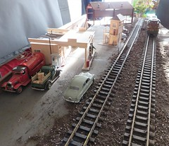 SETUP SHOT - Filling Station by the Tracks (Michael Paul Smith) Tags: setup shot 124th scale diecast vehicles g train behind scenes