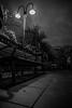 Night Life (pete ramirez) Tags: canon cityscape sidewalk street bw bench 2018 rain drop lamp peteramirez handheld highiso