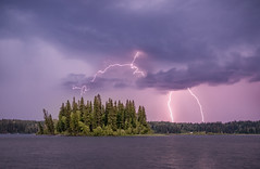 Ness Lake Lightning (robertdownie) Tags: lightning water nesslake britishcolumbia island trees bolts storm clouds canada beautyinnature cloudsky dusk forkedlightning lake lakeview nature nopeople outdoors powerinnature purple scary scenicsnature sky stormcloud thunderstorm