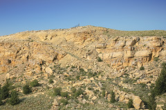Sandstone Cliff (wyojones) Tags: wyoming cody monumenthillroad rattlesnakemountainanticline hogback cuesta cliff sedimentaryrock strata sandstone fence gate slumpblock landslide geology