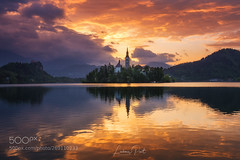 Fiery Morning in Slovenia... (vaterkinder) Tags: 500px lake sky bled slovenia water reflection landscape nature island tourism travel outdoor beautiful europe sunrise mountain sun tree church castle blue idyllic sunset hill landmark view scenic scenery pond