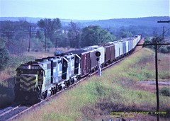 MKT 181 CR 8225-8174, Savanna, OK. 8-24-1980 (jackdk) Tags: train railroad railway locomotive emd emdsd40 emdsd402 sd40 sd402 standardcab mkt missourikansasandtexas cr conrail freighttrain freight grain graintrain oklahoma
