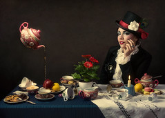 Mad Tea-Party (Giulia Valente) Tags: portrait portraiture woman beauty beautiful alone cinematic cinema movie story romance romantic one looking light shadow dark beam darkness mood moody atmosphere low key dream inspiring wonderland mad hatter tea party table cups macarons cookies painting painterly