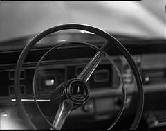 steering wheel on 4x5 film (Garrett Meyers) Tags: rbgraflex4x5 garrettmeyers garrett meyers largeformat 4x5film graflex graflex4x5 film filmphotographer vintage vintagecar interior coolaprilnights redding reddingphotographer chevy cadillac ford mercury homedeveloped handheld
