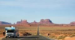 Tourists and camper along the two-lane blacktop US highway 163 in Utah and Arizona with Monument Valley in the background (thstrand) Tags: centerline driving touring tour americanwest americans aridclimate arizona buttes camper campers cars coloradoplateau countryside cruiseamericacom desert destinations famouslocation famousplace famousplaces geologicalformations geology highway163 highways landmark landmarks landscape landscapes locations longroad monumentvalley nativeamericanlands navajonationreservation navajotribalpark outdoors panorama panoramicview parks rv recreationalvehicle road roads roadsideattractions ruralscene sandstone scenicoverlook scenicviews southwest straight tourism touristattraction transportation traveldestination traveldestinations twolaneblacktop usroute163 unitedstatesofamerica utah vacation