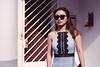 On The Porch (OzGFK) Tags: asia singapore tiongbahru film analog nikon nikkor urban streetphotography 35mm sunglasses people woman pretty beautiful fujisuperia800 fuji shadow sunnyday sunny residential
