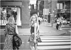 Life Happens at Intersections (Steve Lundqvist) Tags: new york usa states united america manhattan stati uniti travel trip viaggio traveling girl ragazza model bw urban city urbanscape portrait ny nyc persone monocromo ritratto fashion moda mood attractive beauty crossing street road crossroad streetphotography nikon d700 eye contact