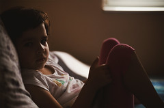Portrait of a Small Girl on Bed (dejankrsmanovic) Tags: girl small young child kid one portrait family candid ordinary life lifestyle living dwelling childhood youth concept bed pillow home domestic children people wakeup furniture sheet window day morning pose comfortable relax rest watching face facial serious